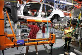 automotive engineers tending to a vehicle