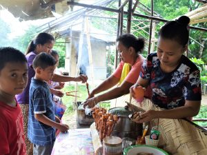 Spending time to eat a local food street in Palawan Islands of the Philippines.