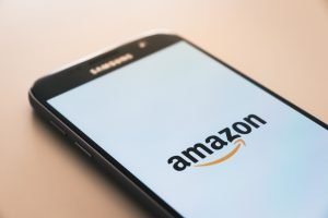 This image shows a smart phone with the Amazon Logo on it. It's a symbol of how Amazon FBA has made lives easy.